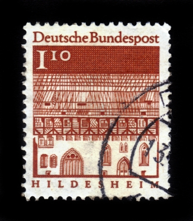 GERMANY - CIRCA 1966  A stamp printed in Germany from the  Historic Buildings  issue showing Trinity Hospital, Hildesheim, circa 1966  Stock Photo - 16348383
