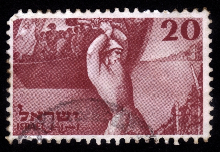 ISRAEL - CIRCA 1950  A stamp printed in Israel, shows arrival of the first settlers in Palestine before the establishment of Israel, devoted to second Independence Day of Israel, circa 1950 photo