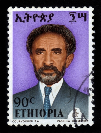 ETHIOPIA - CIRCA 1958   A stamp printed in Ethiopia shows portrait of  emperor Haile Selassie on a red background , with the inscription in Amharic , series, circa 1958 Stock Photo - 16585815