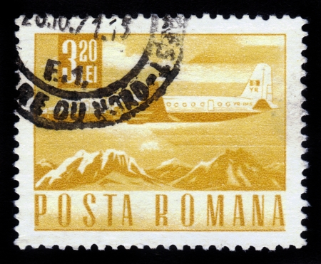 ROMANIA - CIRCA 1967  A stamp printed in Romania shows an IL-18 airliner, flying over mountains , circa 1967  Stock Photo - 16585818