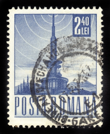 ROMANIA - CIRCA 1967  A stamp printed in the Romania, shows a television tower and the the symbol of broadcast signal, circa 1967 Stock Photo - 16585814