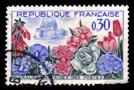 FRANCE - CIRCA 1963  A stamp printed in France shows blooming flowers on a background of medieval Nantes, circa 1963 Stock Photo - 16585821