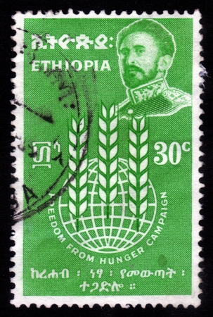haile: ETHIOPIA - CIRCA 1963   A stamp printed in Ethiopia shows image of  emperor Haile Selassie on a green background , with the inscription   freedom from hunger campaign, circa 1963