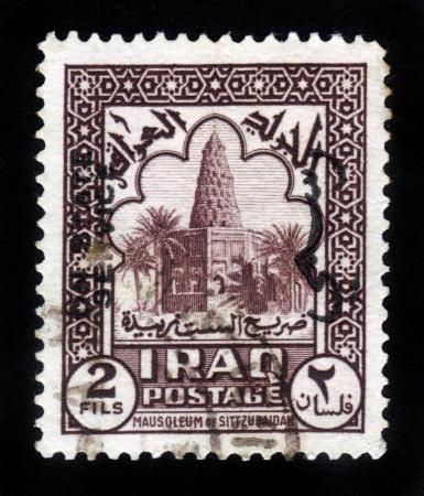 sitt: IRAQ - CIRCA 1942  A stamp printed in Iraq shows image of the Mausoleum of Sitt Zubaidah, circa 1942