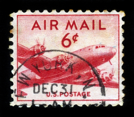 UNITED STATES - CIRCA 1947  stamp printed in United states  USA , shows military transport aircraft Douglas C-54  DC-4  Skymaster , circa 1947 Stock Photo - 16585884