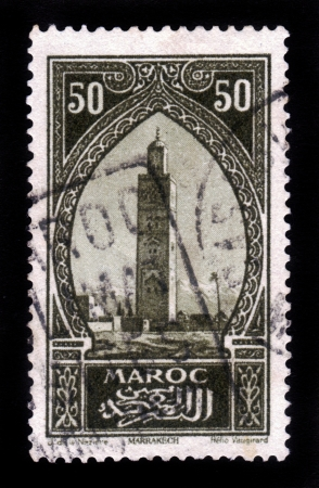 MOROCCO - CIRCA 1934  A stamp printed in Morocco shows Koutoubia, the biggest mosque of the Moroccan city of Marrakesh, circa 1934 Stock Photo - 16585894