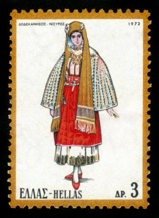 GREECE - CIRCA 1972  A stamp printed in Greece, shows the traditional female dress of the island Nisyros, circa 1972 Stock Photo - 16585891