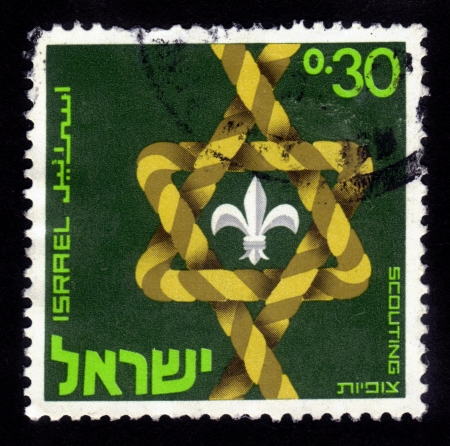 magen: ISRAEL - CIRCA 1968  A stamp printed in Israel shows a stylized Star of David   Magen David   dedicated to the 50th anniversary of the Israel  Scouts Federation  HaTzofim  ; series, circa 1968