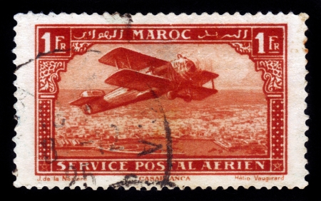 FRENCH MOROCCO - CIRCA 1927  A stamp printed by Morocco, shows old single-engine plane flying over Casablanca, circa 1927 Stock Photo - 16878643