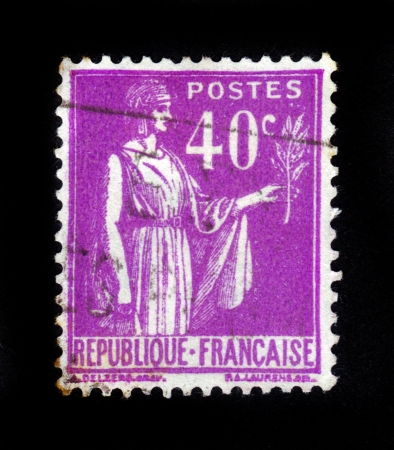 signifier: FRANCE - CIRCA 1933  A stamp printed in France shows a woman with an Olive Branch in hand - allegory of Peace , from the series  Peace , circa 1933 Stock Photo