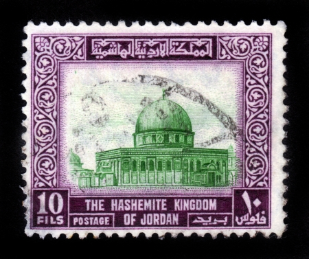 JORDAN-CIRCA 1954 A stamp printed in Jordan shows image of Al-Aqsa Mosque also known as al-Aqsa, is the third holiest site in Sunni Islam and is located in the Old City of Jerusalem, purple, circa 1954