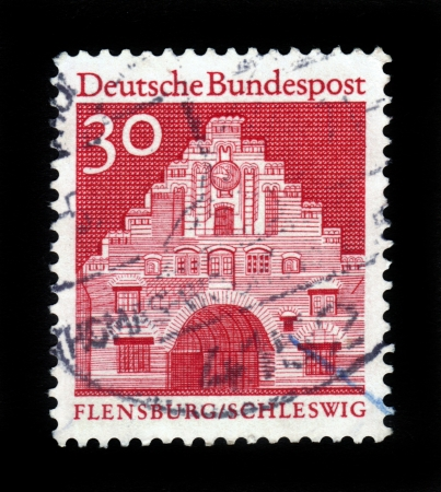 german mark: GERMANY - CIRCA 1966  A stamp printed in Germany from the  Historic Buildings  issue shows Nordertor, Flensburg, Schleswig, circa 1966 Stock Photo