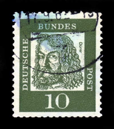 durer: GERMANY - CIRCA 1961  A stamp printed in Germany, shows portrait of Albrecht Durer a German painter, printmaker, mathematician, circa 1961