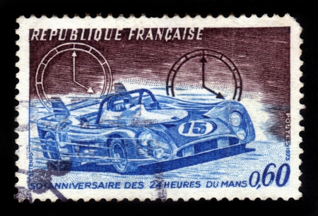 FRANCE - CIRCA 1973  stamp printed by France, shows racing car, devoted to 50th Anniversary of the 24 Hours of Le Mans, circa 1973 photo