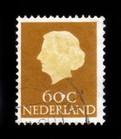 NETHERLANDS - CIRCA 1960: Stamp printed in the Holland shows  the queen Juliana, circa 1960 Stock Photo - 16943114