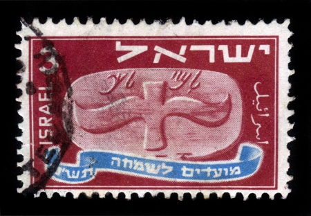 ISRAEL-CIRCA 1948: A stamp printed in Israel, shows Flying Scroll - To the King - seal stamped on the wine and oil jugs given as tax to the king , Jewish new year celebration 5709  circa 1948 Stock Photo - 16944433