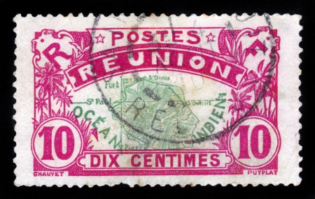 REUNION - CIRCA 1907: A stamp printed in Reunion shows Map of Reunion island , island in the Indian Ocean, east of Madagascar, overseas region of France , circa 1907 Stock Photo - 16944450