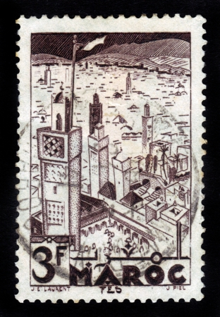 fas: MOROCCO - CIRCA 1951: A stamp printed in French Morocco shows Mosques of  Fez, circa 1951 Stock Photo