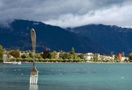 vevey: modern art , big fork in water of Geneva lake  Vevey, Switzerland