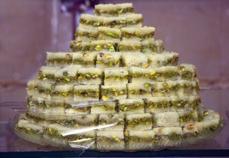 Oriental sweets - baklava ,sweet dessert made of thin pastry, nuts and honey photo