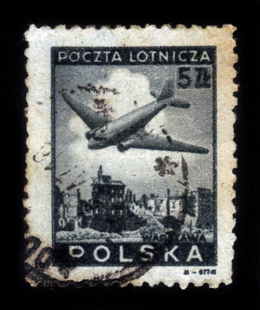 POLAND - CIRCA 1952  A stamp printed in Poland shows airplane over Warsaw ruins , circa 1952 Stock Photo - 16944430