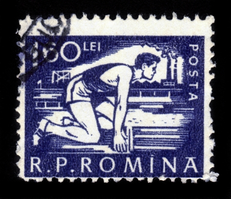 ROMANIA - CIRCA 1956  stamp printed by Romania, shows runner ready to start, circa 1956 Stock Photo - 16944484