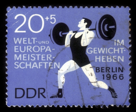 GDR - CIRCA 1966  A stamp printed in GDR  German Democratic Republic - East Germany  shows weightlifter, circa 1966 Stock Photo - 16944426