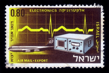 ISRAEL - CIRCA 1968  A stamp printed in Israel, shows electronic measuring device on background signal of oscilloscope and transport aircraft of El Al , series Israel products exported by air, circa 1968 Stock Photo - 16978108