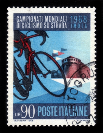 ITALY - CIRCA 1968  A stamp printed in Italy, shows racing bike and the citadel Sforza at Imola , dedicated to  world championship of road cycling in Italy, circa 1968 Stock Photo - 17019590