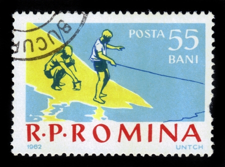 ROMANIA - CIRCA 1962: A stamp printed in the Romania shows boys on a fishing trip, circa 1962. Stock Photo - 17019587