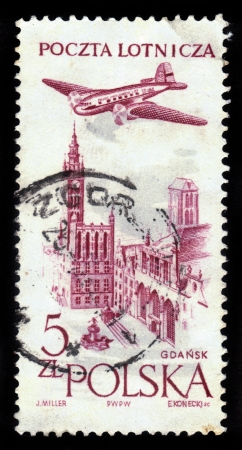 POLAND - CIRCA 1957: a stamp printed in Poland shows plane flying over Gdansk, circa 1957 Stock Photo - 17019595