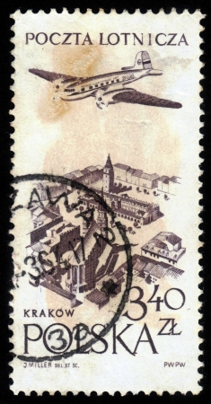 POLAND - CIRCA 1957: a stamp printed in Poland shows plane flying over Krakow, circa 1957 Stock Photo - 17019594