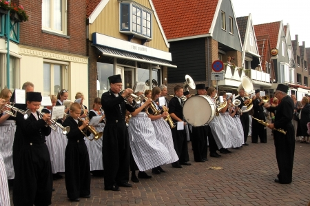 volendam: Volendam,  Netherlands - June 24  Festival of folk music ensembles, orchestra of wind instruments on June 24, 2007 in the fishing village of Volendam,  Netherlands Editorial