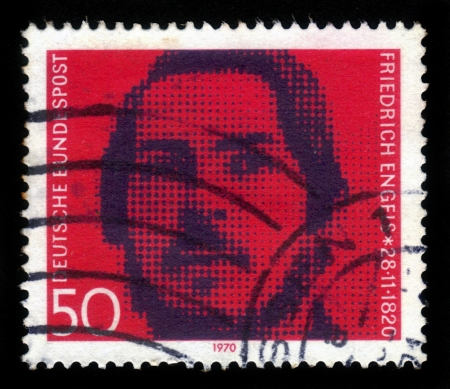 GERMANY - CIRCA 1970: a stamp printed in the Germany shows portrait of the young Friedrich Engels, socialist, circa 1970 Stock Photo - 17113095