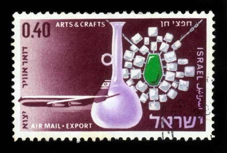 ISRAEL - CIRCA 1968: A stamp printed in Israel, shows jewelry with emerald and a glass jar on the background of the transport plane El-Al , series Israel products exported by air, circa 1968 Stock Photo - 17113106