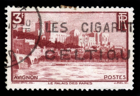 FRANCE - CIRCA 1938  stamp printed by France, shows the Palace of the Popes and the Bridge Benazet  in Avignon, France, circa 1938 Stock Photo - 17175925