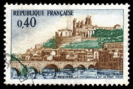 FRANCE - CIRCA 1968  stamp printed by France, shows the Old Bridge   pont vieux   and Saint Nazaire Cathedral at Beziers, France, circa 1968 Stock Photo - 17175923