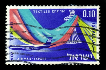 ISRAEL - CIRCA 1968: A stamp printed in Israel, shows textile fabric on the background of the transport plane El-Al , series Israel products exported by air, circa 1968 Stock Photo - 17175926