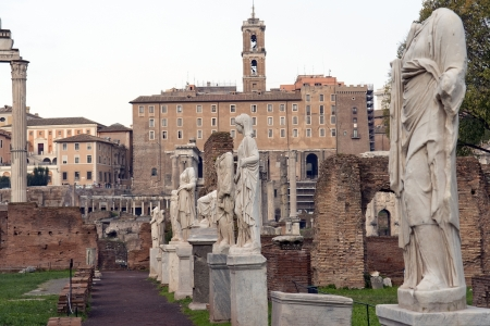 Ancient Roman statues stand on pedestals in the open air in Forum Romano , Rome, Italy photo