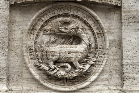 bas-relief of a fire-breathing dragon on the facade of the Church of St  Louis of the French,  titular church in Rome, Piazza Navona Stock Photo - 17312311