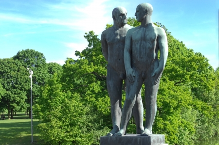 OSLO, NORWAY - May 28: sculptures of two naked males in Vigeland park in Oslo, Norway on May 28, 2008. installed in the park 212 bronze and granite sculptures created by Gustav Vigeland. Stock Photo - 17202152