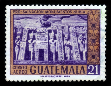 GUATEMALA - CIRCA 1960  A stamp printed in the Guatemala, shows Temple of Hathor, dedicated to the wife of Ramses II,  Nefertari, Abu Simbel ,  The complex is part of the UNESCO World Heritage Site known as the  Nubian Monuments  , circa 1960 Stock Photo - 17326953