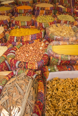 sale of various nuts and spices in canvas bags in east market photo
