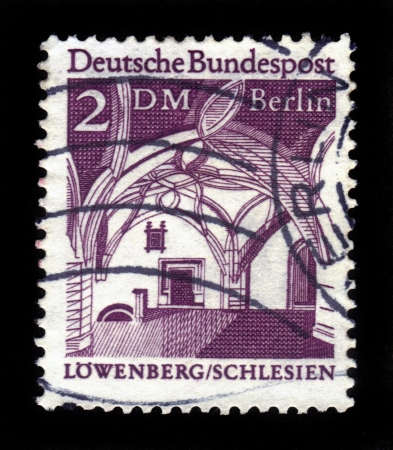 GERMANY - CIRCA 1966  A stamp printed in Germany showing Citizens  Hall in the City Hall, Lowenberg in Silesia , from the  Historic Buildings , circa 1966  Stock Photo - 17326950