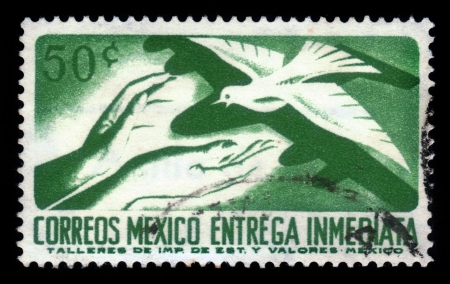 MEXICO - CIRCA 1969: A Stamp printed in Mexico shows hands of people who are ready to accept the white dove, circa 1969 Stock Photo - 17326959