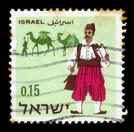 Israel - CIRCA 1966: a stamp printed by Israel shows postmen - past and present - turkish postmen and camels, circa, 1966 Stock Photo - 17326955