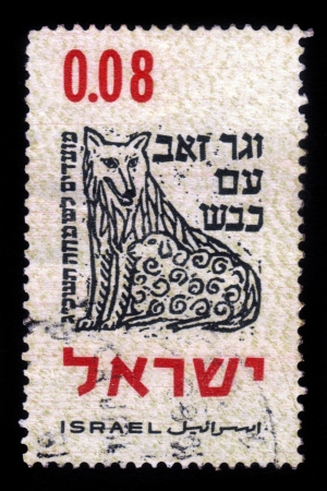 isaiah: ISRAEL - CIRCA 1962: A stamp printed in Israel, shows symbolic drawing of wolf, hebrew inscription ...and the wolf shall dwell with the lamb... (Isaiah 11, 6), circa 1962
