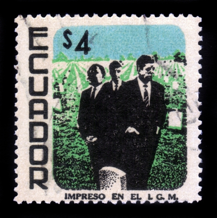 Ecuador - CIRCA 1969: A stamp printed in Ecuador shows image of Martin Luther King, John Fitzgerald Kennedy and Robert Fitzgerald Kennedy, against the background of Memorial Cemetery, circa 1969 Stock Photo - 17377570