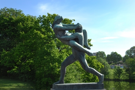 OSLO, NORWAY - May 28: sculpture of a man holding a girl who resists in Vigeland park in Oslo, Norway on May 28, 2008. installed in the park 212 bronze and granite sculptures created by Gustav Vigeland. Stock Photo - 17377569