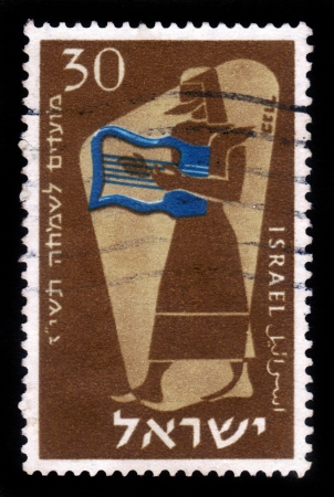 ISRAEL - CIRCA 1956: A stamp printed in Israel, shows symbolic drawing of musician and musical instruments of biblical times - harp,circa 1956 Stock Photo - 17377848